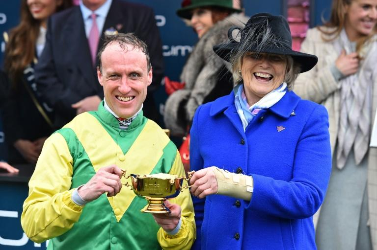 Jockey Robbie Power (L) and Irish trainer Jessica Harrington celebrate winning the Gold Cup with their horse Sizing John on the last day of the Cheltenham Festival at Cheltenham Racecourse in Gloucestershire, south-west England, on March 17, 2017