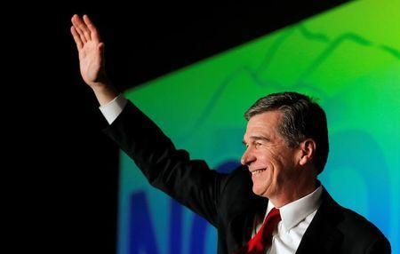 Roy Cooper, North Carolina candidate for governor, waves to supporters during an election night party in Raleigh, North Carolina, U.S. November 9, 2016. REUTERS/Chris Keane