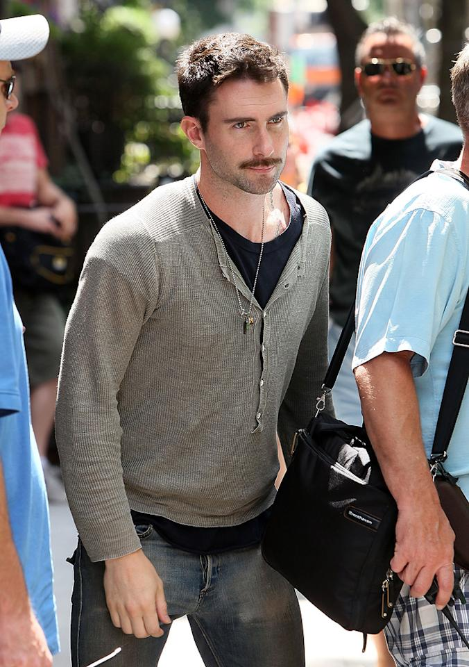 "Adam Levine filming on location for ""Can a Song Save Your Life?"" on July 2, 2012 in New York City."
