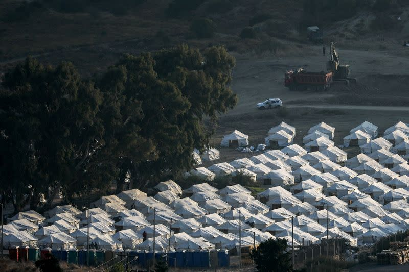 Greek PM promises permanent migrant centre after fire on Lesbos
