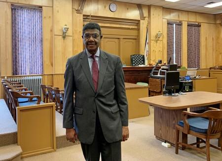 Judge Booker T. Stephens poses in his courtroom in Welch