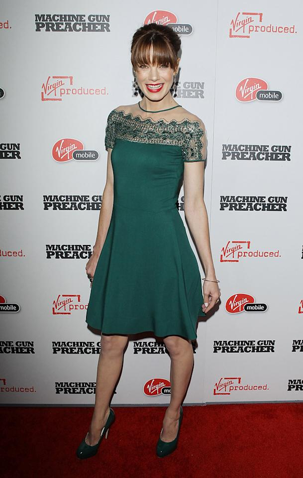 "Michelle Monaghan looks more grandma than glam in this beaded green Valentino dress at the Los Angeles premiere of ""Machine Gun Preacher"" on September 21, 2011."