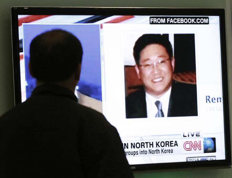 "A South Korean man watches a television news program showing Korean American Kenneth Bae at the Seoul Railway Station in Seoul, South Korea, Thursday, May 2, 2013. Bae detained for six months in North Korea has been sentenced to 15 years of hard labor for ""hostile acts"" against the state, the North's media said Thursday — a move that could trigger a visit by a high-profile American if history is any guide. (AP Photo/Ahn Young-joon)"