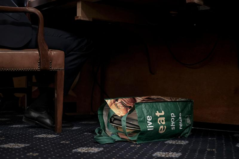 A reusable shopping bag filled with documents and notes sit at the feet of Stephen Castor, the Republican counsel to the Judiciary and Intelligence committee, at the beginning of the House Judiciary Committee hearing on the impeachment inquiry in Washington, D.C., on Dec. 9, 2019. | Gabriella Demczuk for TIME