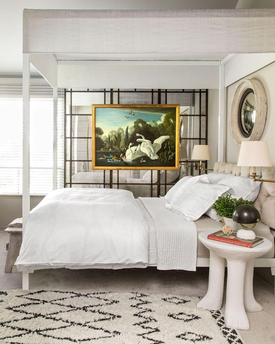 <p>Mirrored walls will make a room appear larger than it is while also giving your artwork a more interesting backdrop. Antiqued mirrors boast glamorous vibes, too. </p>