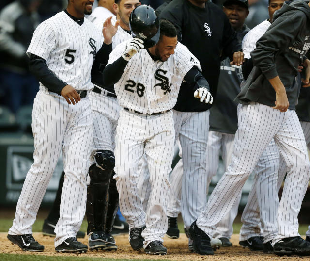 Chicago White Sox's Leury Garcia (28) celebrates with teammates after scoring to end a baseball game against the Minnesota Twins in the eleventh inning on Wednesday, April 2, 2014, in Chicago. The White Sox won 7-6. (AP Photo/Andrew A. Nelles)