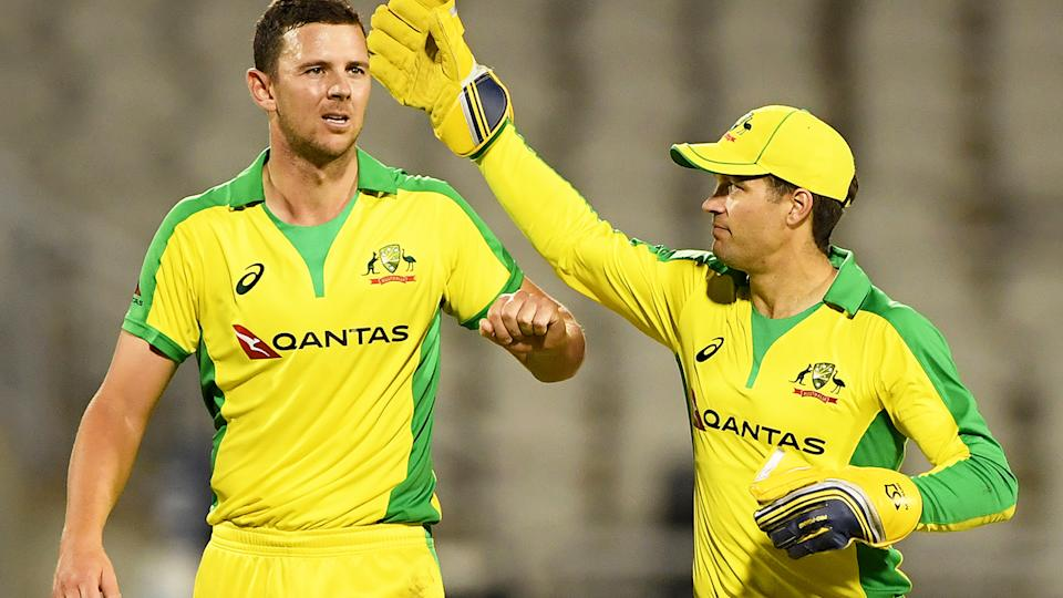 Josh Hazlewood and Alex Carey, pictured here during the first ODI between Australia and England.