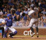 Colorado Rockies' Corey Dickerson reacts to a high pitch from Chicago Cubs' Edwin Jackson, as catcher Welington Castillo grabs the ball, during the fourth inning of a baseball game Tuesday, July 29, 2014, in Chicago. (AP Photo/Charles Rex Arbogast)