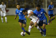 United States' Tyler Adams, center, and El Salvador's Melvin Cartagena, fight for the ball during a qualifying soccer match for the FIFA World Cup Qatar 2022 at Cuscatlan stadium in San Salvador, El Salvador, Thursday, Sept. 2, 2021. (AP Photo/Moises Castillo)