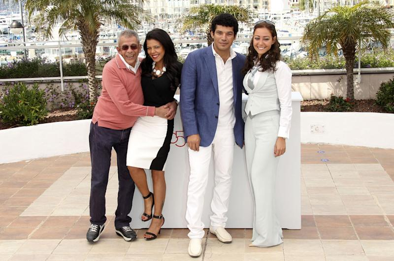 Cast members from left, Director Yousry Nasrallah, Nahed El Sebai, Bassem Samra and Menna Shalaby during a photo call for After the Battle at the 65th international film festival, in Cannes, southern France, Thursday, May 17, 2012. (AP Photo/Joel Ryan)
