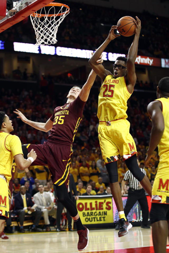 Maryland forward Jalen Smith (25) grabs a rebound over Minnesota center Matz Stockman (35), of Norway, in the first half of an NCAA college basketball game, Friday, March 8, 2019, in College Park, Md. (AP Photo/Patrick Semansky)