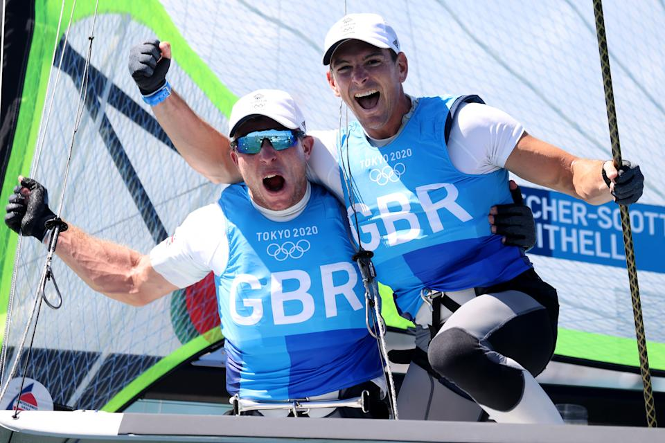 FUJISAWA, JAPAN - AUGUST 03: Dylan Fletcher (R) and Stuart Bithell of Team Great Britain celebrate as they win gold in the Men's Skiff 49er class on day eleven of the Tokyo 2020 Olympic Games at Enoshima Yacht Harbour on August 03, 2021 in Fujisawa, Japan. (Photo by Phil Walter/Getty Images)