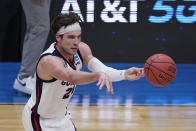 Gonzaga forward Corey Kispert (24) passes up court during the first half of an Elite 8 game against Southern California in the NCAA men's college basketball tournament at Lucas Oil Stadium, Tuesday, March 30, 2021, in Indianapolis. (AP Photo/Darron Cummings)