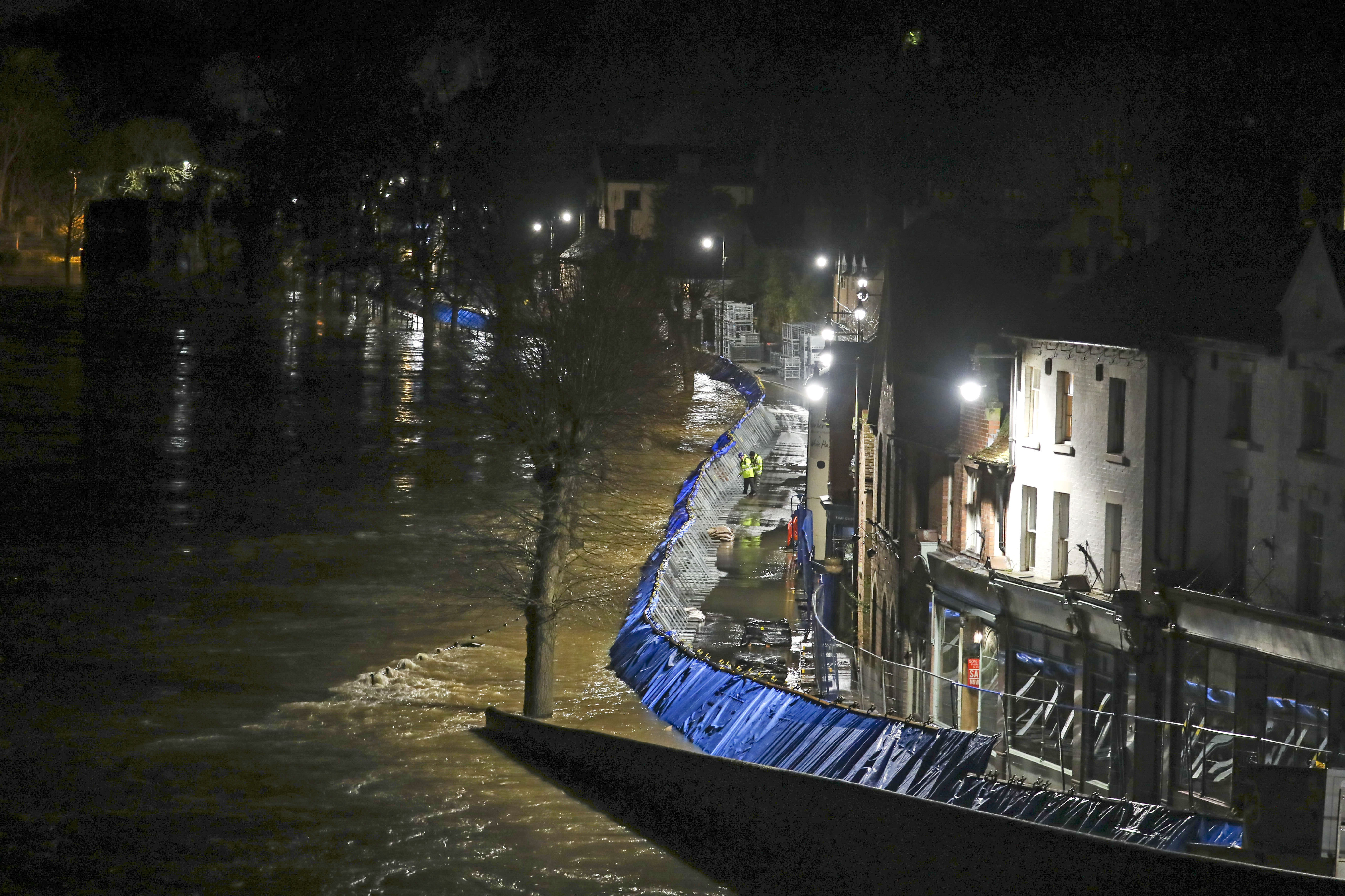 Temporary flood barriers hold back the river Severn in Ironbridge, Shropshire, in the aftermath of Storm Dennis. (Photo by Steve Parsons/PA Images via Getty Images)