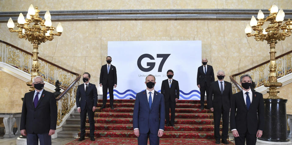 G7 foreign ministers wear face masks and are socially distanced for a group photo, with front row left, European High Representative of the Union for Foreign Affairs Josep Borrell, British Foreign Secretary Dominic Raab, U.S. Secretary of State Antony Blinken, middle row left to right, German Federal Minister for Foreign Affairs Heiko Maas, Japanese Minister of Foreign Affairs Motegi Toshimitsu and Canadian Minister of Foreign Affairs Marc Garneau, back row from left, Italian Minister of Foreign Affairs Luigi Di Maio and French Minister of Europe and Foreign Affairs Jean-Yves Le Drian, on the stairs at Lancaster House in London ahead of bilateral talks at the G7 Foreign and Development Ministers meeting in London, Tuesday May 4, 2021.(Stefan Rousseau/Pool via AP)