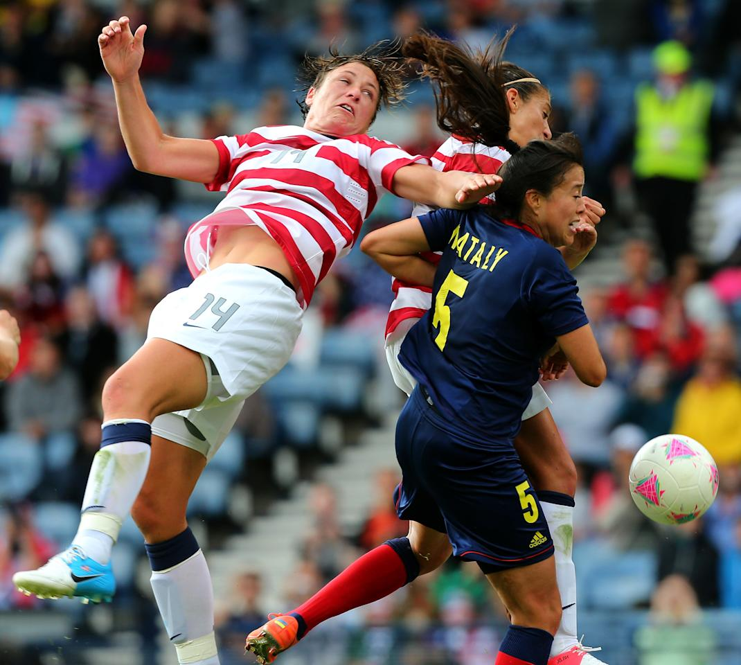 GLASGOW, SCOTLAND - JULY 28:  Abby Wambach of USA battles with Nataly Arias of Columbia during the Women's Football first round Group G match between United States and Colombia on Day 1 of the London 2012 Olympic Games at Hampden Park on July 28, 2012 in Glasgow, Scotland.  (Photo by Stanley Chou/Getty Images)