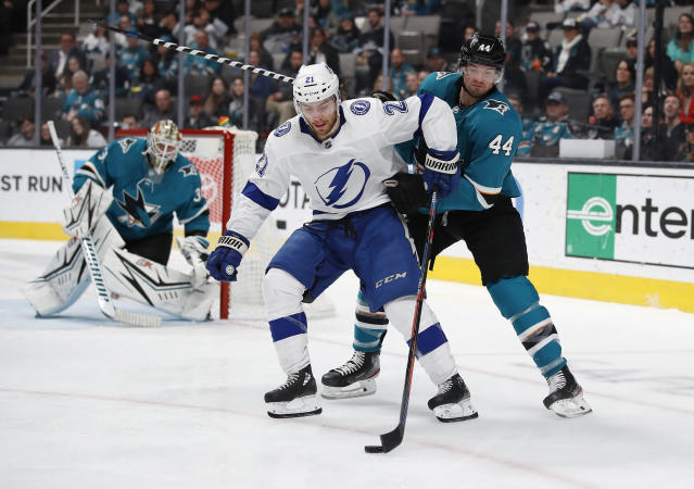 Tampa Bay Lightning center Brayden Point (21) shields the puck from San Jose Sharks defenseman Marc-Edouard Vlasic (44) during the second period of an NHL hockey game in San Jose, Calif., Saturday, Feb. 1, 2020. (AP Photo/Josie Lepe)