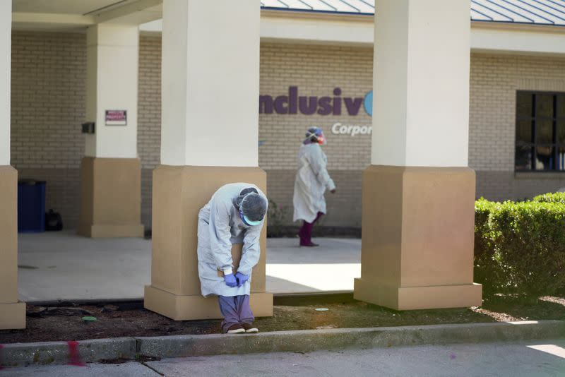 FILE PHOTO: A worker takes a break as the Moderna coronavirus disease (COVID-19) vaccination is distributed during a drive through event where one hundred vaccinations were to be administered at InclusivCare in Avondale