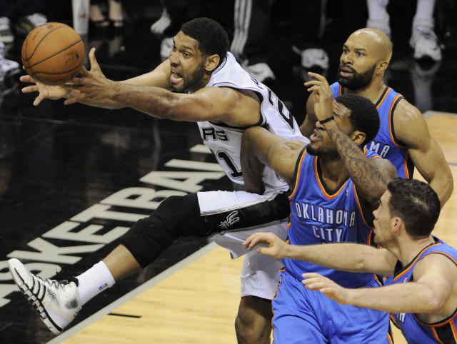 San Antonio Spurs forward Tim Duncan, left, chases the loose ball against Oklahoma City Thunder's Nick Collison, right, Perry Jones, and Derek Fisher, right rear, during the first half of Game 2 of the Western Conference finals NBA basketball playoff series, Wednesday, May 21, 2014, in San Antonio. (AP Photo/Darren Abate)