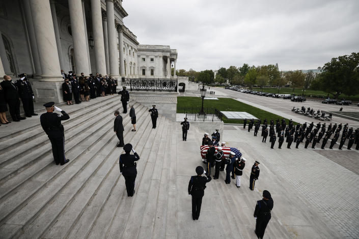 "An honor guard carries the flag-draped casket of slain U.S. Capitol Police officer William ""Billy"" Evans up the Capitol steps to the Capitol rotunda where he will lie in honor Tuesday, April 13, 2021 in Washington. (Carlos Barria/Pool via AP)"