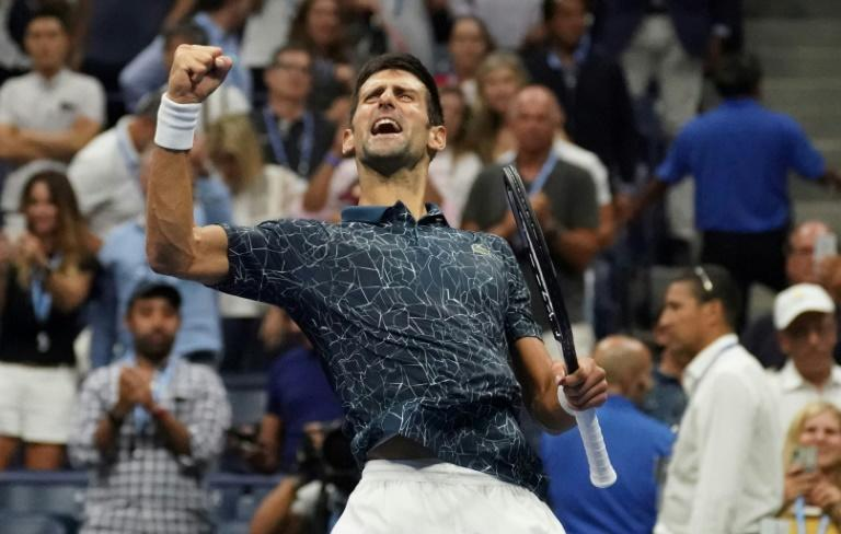 Sampras in his sights: Novak Djokovic celebrates his semi-final win against Kei Nishikori