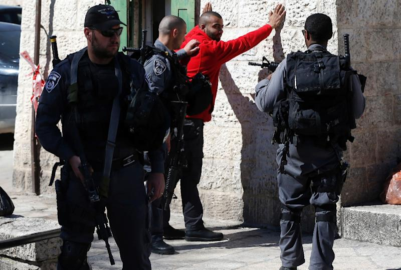 Israeli police body-check a Palestinian youth at Damascus Gate in the Old City of Jerusalem (AFP Photo/Ahmad Gharabli)