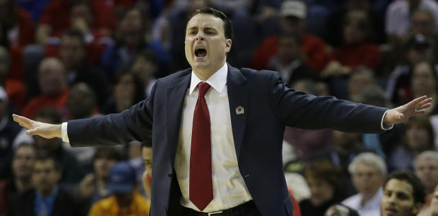 Dayton head coach Archie Miller speaks to players against Stanford during the first half in a regional semifinal game at the NCAA college basketball tournament, Thursday, March 27, 2014, in Memphis, Tenn. (AP Photo/Mark Humphrey)