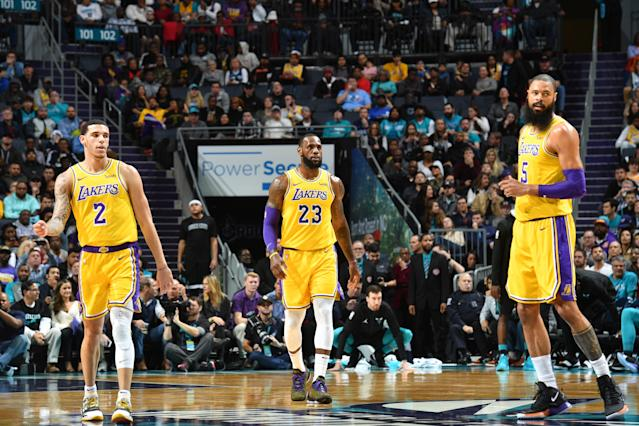 """<a class=""""link rapid-noclick-resp"""" href=""""/nba/players/5764/"""" data-ylk=""""slk:Lonzo Ball"""">Lonzo Ball</a> and <a class=""""link rapid-noclick-resp"""" href=""""/nba/players/3704/"""" data-ylk=""""slk:LeBron James"""">LeBron James</a> became the first <a class=""""link rapid-noclick-resp"""" href=""""/nba/teams/lal"""" data-ylk=""""slk:Lakers"""">Lakers</a> to each record a triple-double in the same game since Magic Johnson and Kareem Abdul-Jabbar in 1982. (Getty Images)"""