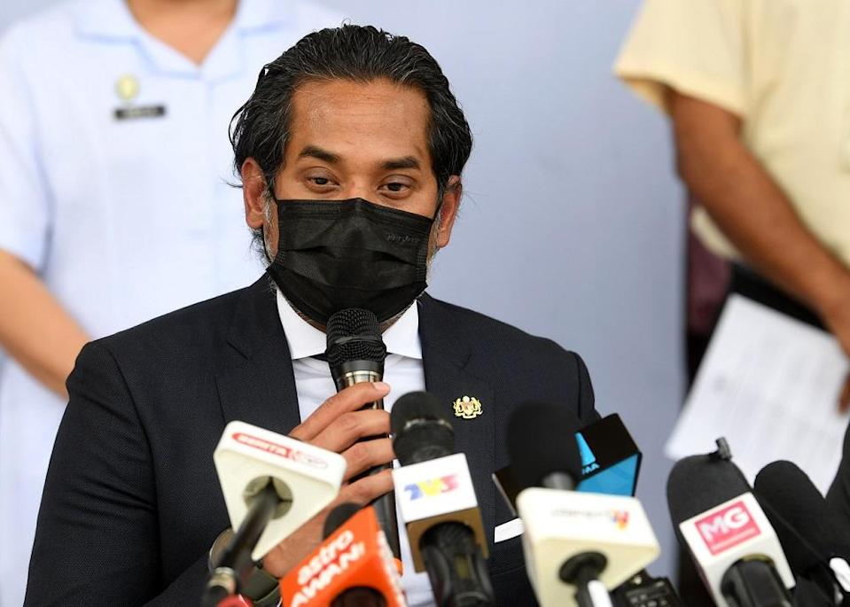 The coordinating minister for National Covid-19 Immunisation Programme Khairy Jamaluddin speaks to reporters during a press conference in Putrajaya February 24, 2021. — Bernama pic