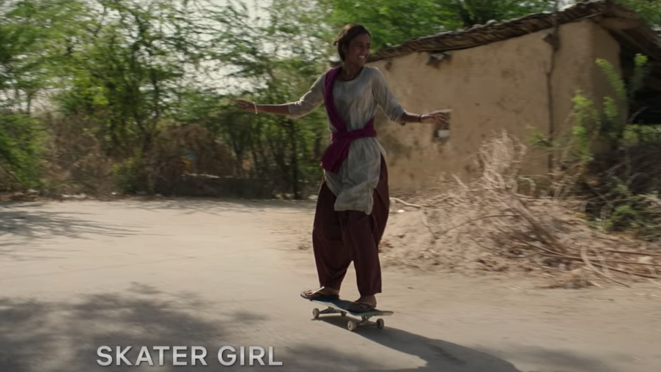 A young woman on a skateboard.