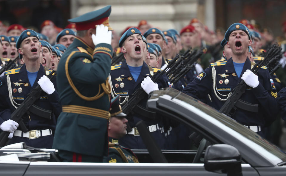 Russian Defense Minister Sergei Shoigu salutes to his soldiers as he is driven along Red Square in the Aurus Senat car during the Victory Day military parade in Moscow, Russia, Sunday, May 9, 2021, marking the 76th anniversary of the end of World War II in Europe. (AP Photo)