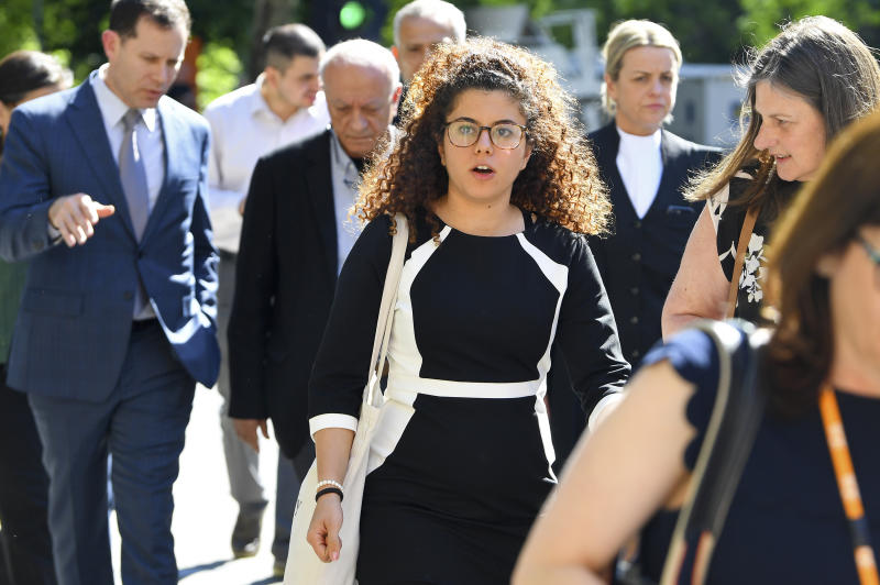Noor Massarwe, center, the sister of murdered exchange student, Aiia Maasarwe, arrives at the Supreme Court of Victoria in Melbourne, Australia, Tuesday, Oct. 29, 2019. A judge has sentenced Codey Herrmann to 36 years in prison for the murder and rape of Aiia Maasarwe, an Israeli student, in January. (James Ross/AAP Image via AP)