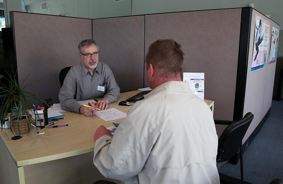 Accountant Mike McGirr (L) helps a customer at Liberty Tax Service in San Francisco. (Photo: Justin Sullivan/Getty Images)