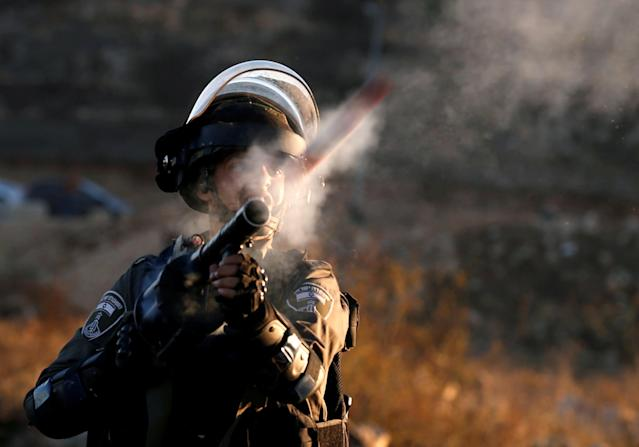 "<p>An Israeli border policeman reacts as he fires towards Palestinian protesters during clashes as Palestinians call for a ""day of rage"" in response to President Donald Trump's recognition of Jerusalem as Israel's capital, near the Jewish settlement of Beit El, near the West Bank city of Ramallah, Dec. 8, 2017. (Photo: Mohamad Torokman/Reuters) </p>"