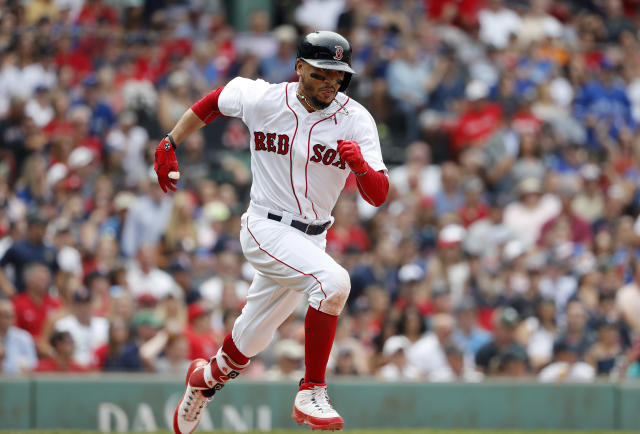 Boston Red Sox's Mookie Betts runs out a hit against the Toronto Blue Jays during the ninth inning of a baseball game Saturday, July 14, 2018, in Boston. (AP Photo/Winslow Townson)