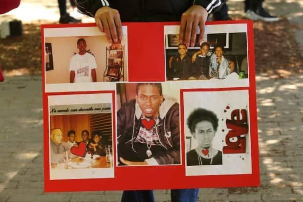 At a June 13, 2020 vigil and rally for Jamal Francique, family members displayed photos of him. Francique, 28, was shot in the back of the head while in his car during an attempted arrest on Jan. 7, 2020. He was put on life support and died in hospital two days later. (Michael Charles Cole/CBC - image credit)