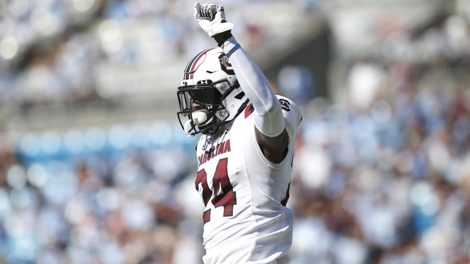 Israel Mukuamu raises his fist in celebration during a game.