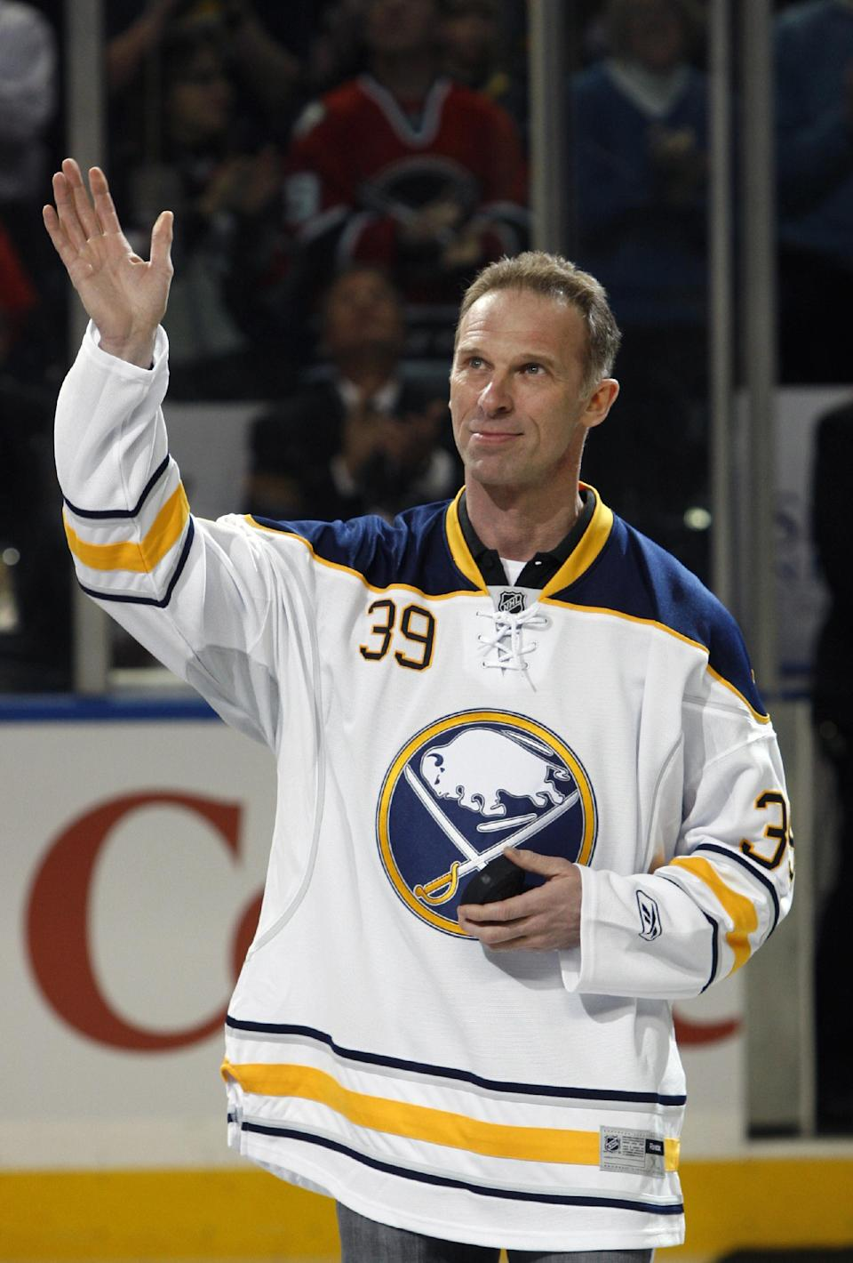 FILE - In this March 19, 2011 file photo, Buffalo Sabres former goalie Dominik Hasek waves to the fans during a pre-game ceremony before an NHL hockey game against the Atlanta Thrashers in Buffalo, N.Y. Hasek is expected to be part of the class of 2014 at the Hockey Hall of Fame, which will be announced Monday, June 23, 2014. (AP Photo/David Duprey, File)