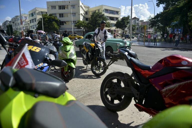 Authorities estimate there are 210,000 electric motorcyles in use in Cuba (AFP Photo/YAMIL LAGE)