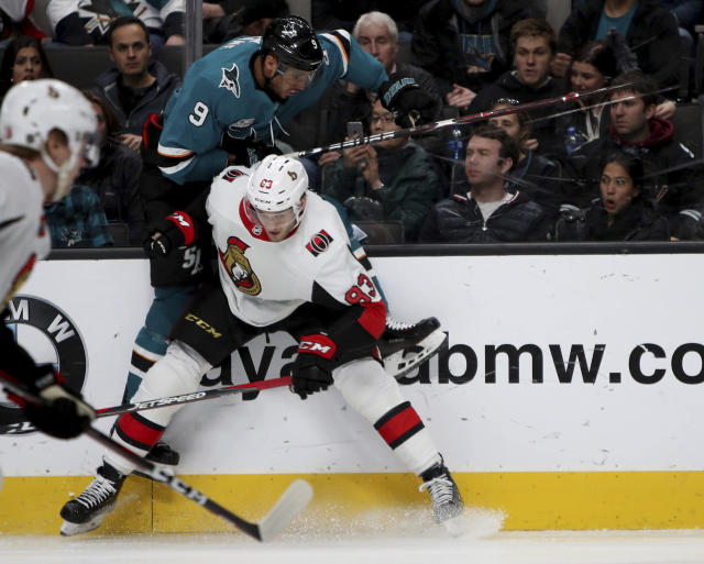 Ottawa Senators defenseman Christian Jaros (83) checks San Jose Sharks left wing Evander Kane (9) into the boards during the first period of an NHL hockey game in San Jose, Calif., Saturday, Jan. 12, 2019. (AP Photo/Scot Tucker)