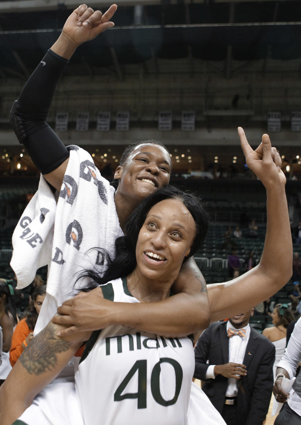 Miami's Shawnice Wilson (40) and and Maria Brown celebrate after Miami defeated Duke 69-65 during an NCAA college basketball game in Coral Gables, Fla., Thursday, Feb. 28, 2013. (AP Photo/Luis M. Alvarez)