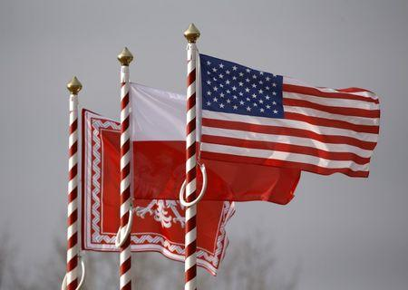 U.S., Poland's flags and jack of the President of Poland are seen during the inauguration ceremony of bilateral military training between U.S. and Polish troops in Zagan
