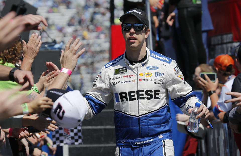 FILE - In this March 24, 2019 file photo, NASCAR Cup Series driver Brad Keselowski greets fans during driver introductions prior to the NASCAR Cup Series auto race at the Martinsville Speedway in Martinsville, Va. Keselowski didn't get the finish he hoped for last weekend of April 4, 2021, when NASCAR's Cup Series ran on the dirt at Bristol Motor Speedway, but the 2012 champion didn't dwell too long on his 11th place finish. (AP Photo/Steve Helber, File)