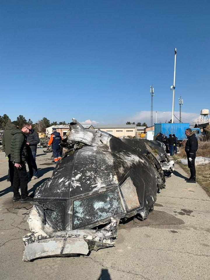 Pictured is the Ukraine International Airlines flight split in half after being shot down by Iranian missiles.
