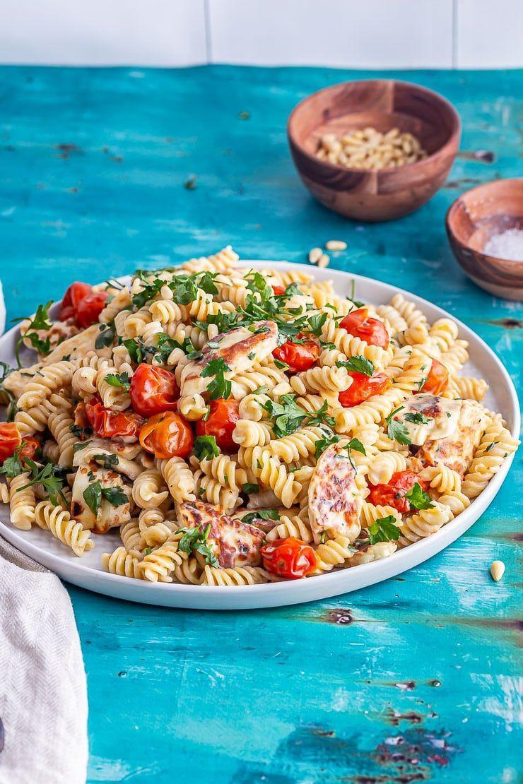 """<p>This pasta is made with roasted tomatoes, pine nuts and a creamy tahini dressing. And you can serve it hot or cold. </p><p>Get the <a href=""""https://thecookreport.co.uk/halloumi-pasta/"""" rel=""""nofollow noopener"""" target=""""_blank"""" data-ylk=""""slk:Halloumi Pasta with Tahini Dressing"""" class=""""link rapid-noclick-resp"""">Halloumi Pasta with Tahini Dressing</a> recipe.</p><p>Recipe from <a href=""""https://thecookreport.co.uk/"""" rel=""""nofollow noopener"""" target=""""_blank"""" data-ylk=""""slk:The Cook Report"""" class=""""link rapid-noclick-resp"""">The Cook Report</a>.</p>"""