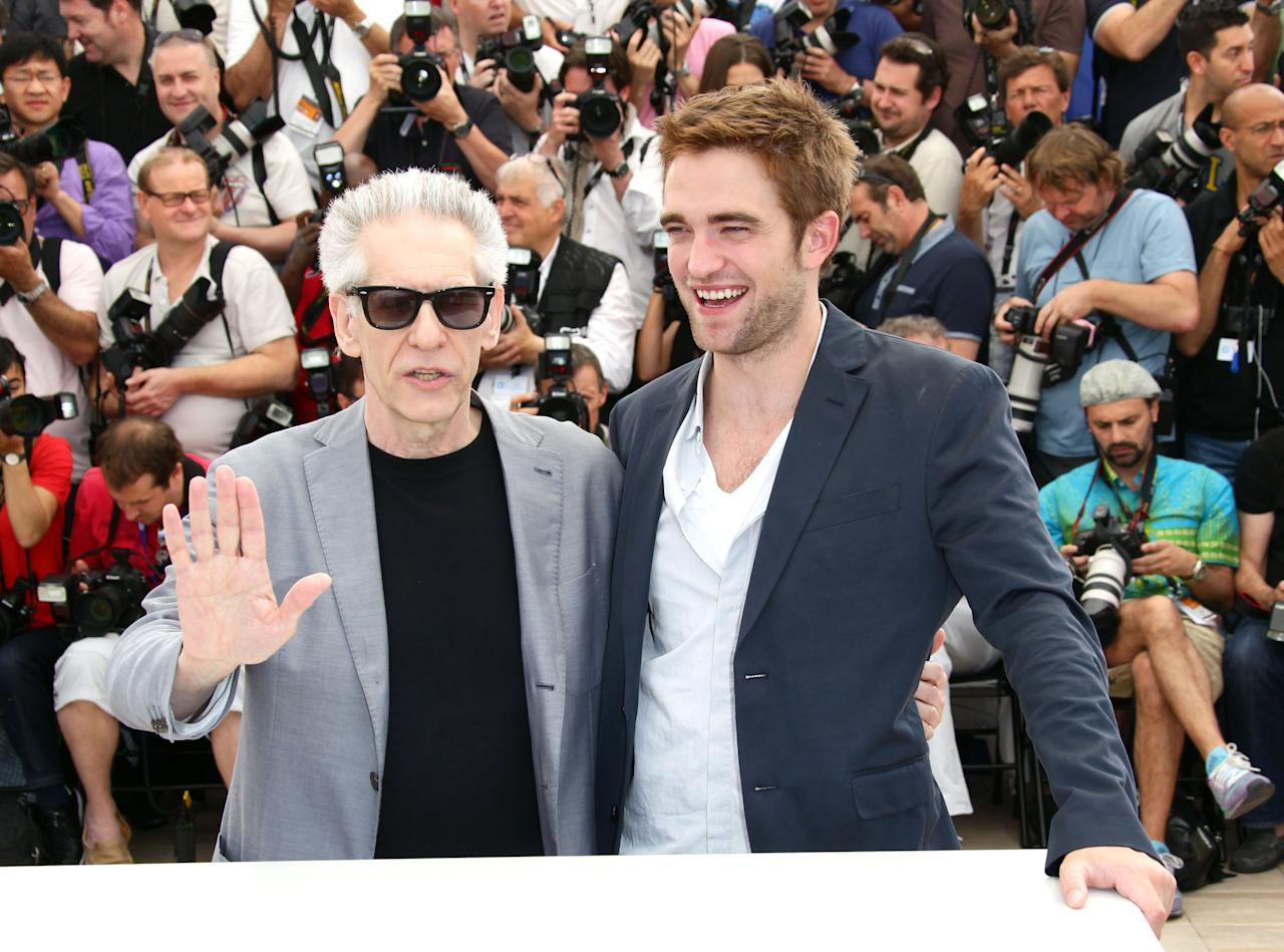 "CANNES, FRANCE - MAY 25:  Actor Robert Pattinson and director David Cronenberg pose at the ""Cosmopolis"" photocall during the 65th Annual Cannes Film Festival at Palais des Festivals on May 25, 2012 in Cannes, France.  (Photo by Vittorio Zunino Celotto/Getty Images)"