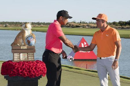 December 3, 2017; New Providence, The Bahamas; Tiger Woods (left) shakes hands with winner Rickie Fowler (right) after the final round of the Hero World Challenge golf tournament at Albany. Mandatory Credit: Kyle Terada-USA TODAY Sports