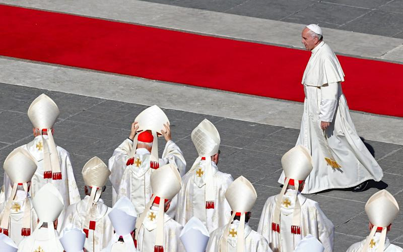 Cardinal Bertone served under Pope Benedict XVI but fell out of favour when Pope Francis was elected in 2013. - Credit: Reuters