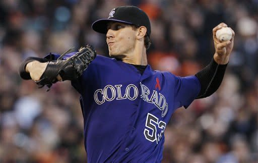 Colorado Rockies pitcher Christian Friedrich (53) delivers against the San Francisco Giants during the second inning of a baseball game in San Francisco, Monday, May 14, 2012. (AP Photo/Jeff Chiu)