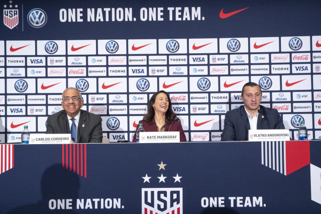 Carlos Cordeiro, left, president of the United States Soccer Federation, and Kate Markgraf, center, general manager of the United States women's national soccer team, listen as Vlatko Andonovski, right, speaks during a news conference, Monday, Oct. 28, 2019, in New York. Cordeiro named Andonovski as head coach in U.S. Women's National Team on Monday.(AP Photo/Mary Altaffer)